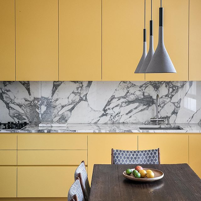 First images from our duplex remodelling project. 📷 @taranwilkhu  #yellow #kitchen #foscarini #calacatta #marble #slidingdoors #wallstorage