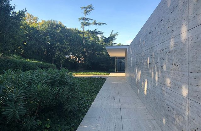 Mies Van Der Rohe's German pavilion from the 1929 World Expo, rebuilt 1986.  Looking as fresh and timeless today as at its opening (last image). So much so that the 20s attired dignitaries look strangely out of place.  #lessismore #miesvanderrohe #modernism #bauhaus #travertine #onyx