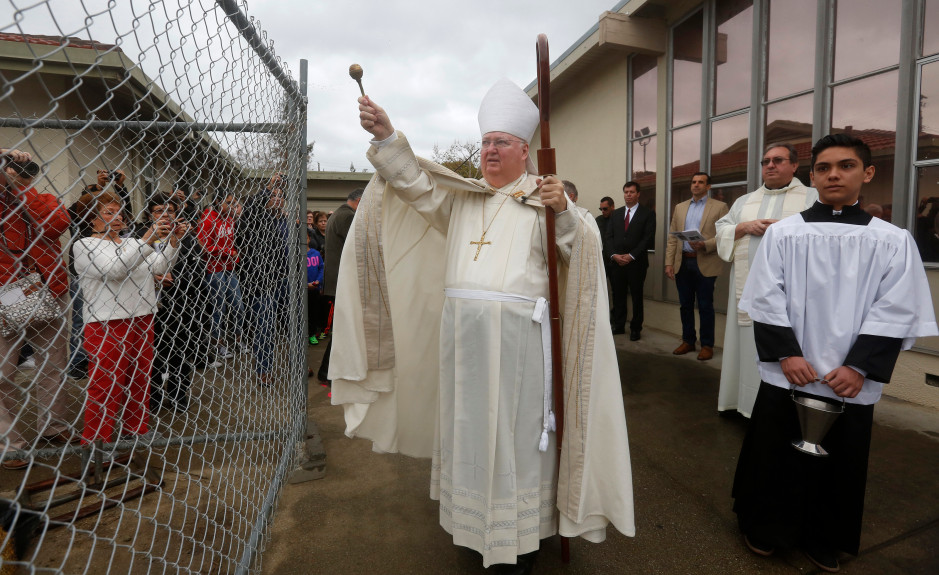 Bishop Patrick McGrath is shown blessing the construction site as the Holy Cross Church, which was destroyed by fire, was rededicated in San Jose in December. The Bishop inspired participants at a forum at the Shia Center on Martin Luther King Day. (Patrick Tehan/Bay Area News Group)