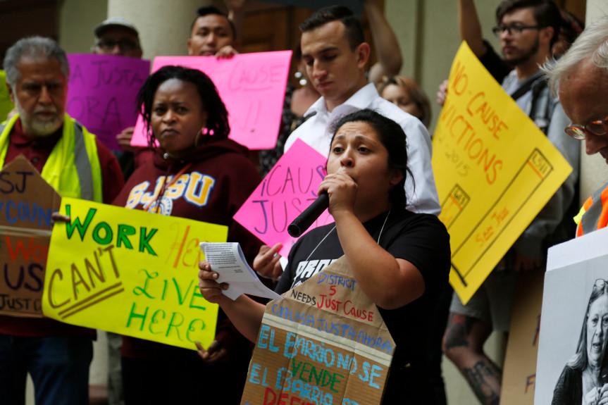 Jocelin Hernandez, center, addresses the crowd tenants' rights advocates prepare to march down the Alameda in San Jose on April 7. (Patrick Tehan/Bay Area News Group)