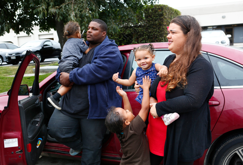 Ashante and Jennifer Parker and kids Amarion, 2, Tristen, 4, and one-year-old, Aria, take a break from living in their car in Gilroy, Calif., on Monday, August 14, 2017. Jennifer and Ashante Parker couldn't make rent on their Modesto apartment after Ashante suffered an injury to his back and have lived out of the car for the past few months. (Gary Reyes/ Bay Area News Group)
