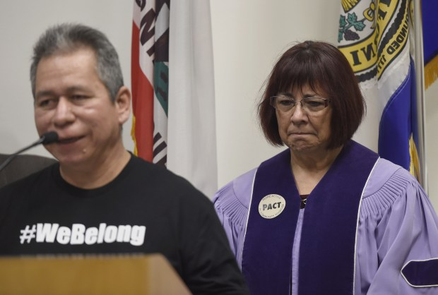 Liliana Devalle, pastor at Grace Baptist Church, listens as Ernesto Perez spoke this month at a news conference at San Jose City Hall, where city officials, local community leaders and members of People Acting in Community Together (PACT) discussed the resources and services available to undocumented immigrants amid rumors of impending ICE raids. (Dan Honda/Bay Area News Group)