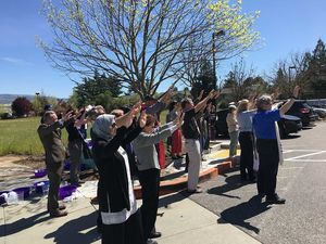 At the conclusion of the March 29 Holy Thursday foot washing ceremony—a show of solidarity with immigration detainees—clergy leaders and activists turned to bless the federal facility in Morgan Hill. -By Michael Moore