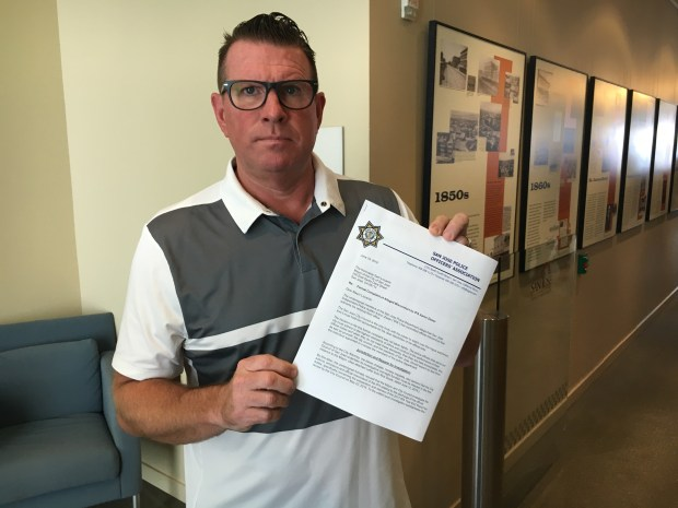 Sgt. Paul Kelly, president of the San Jose Police Officers' Association, holds up a letter that calls for the investigation and removal of Independent Police Auditor Aaron Zisser over alleged ethics violations in an annual audit report, at San Jose City Hall on June 25, 2018. (Robert Salonga/Bay Area News Group)