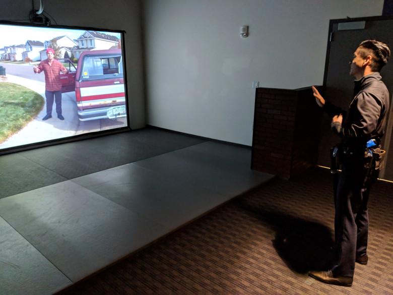Assemblyman Evan Low, D-Campbell, interacts with the San Jose Police Department's force-option simulator at the SJPD substation in South San Jose on Aug. 17, 2018. (Robert Salonga/Bay Area News Group)
