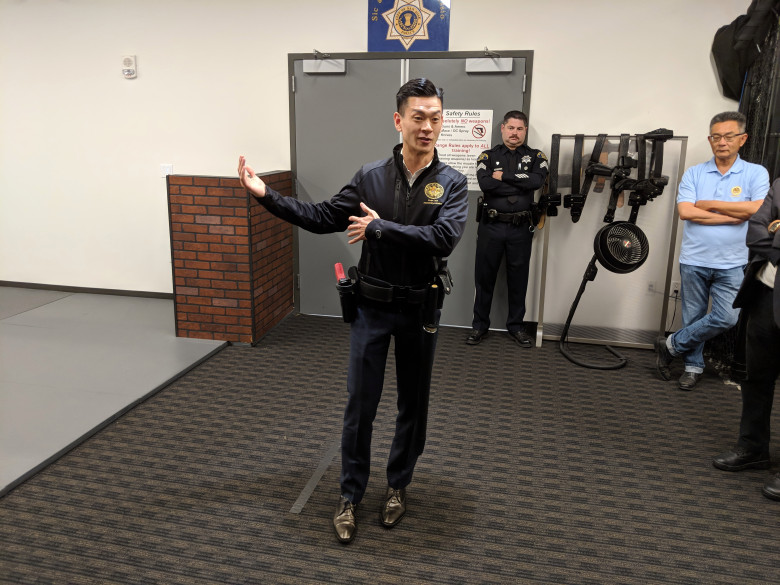 Assemblyman Evan Low, D-Campbell, is debriefed after interacting with the San Jose Police Department's force-option simulator at the SJPD substation in South San Jose on Aug. 17, 2018. (Robert Salonga/Bay Area News Group)
