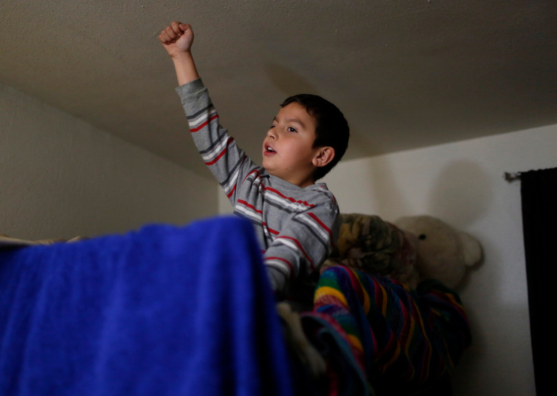 Mountain View, CA - DECEMBER 4: Johnatan Flores Carrillo, 5, sings in his bedroom of his families apartment on W. Middlefield Rd. in Mountain View, Calif., on Tuesday, Dec. 4, 2018. Mountain View city officials are considering a developer's proposal to raze 20 rent-controlled, affordable apartments and replace them with 15 new, luxury town houses. (Nhat V. Meyer/Bay Area News Group)