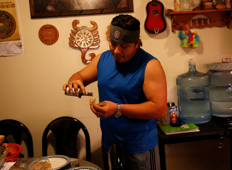 Mountain View, CA - DECEMBER 4: Roberto Flores get a snack in their apartment on W. Middlefield Rd. in Mountain View, Calif., on Tuesday, Dec. 4, 2018. Mountain View city officials are considering a developer's proposal to raze 20 rent-controlled, affordable apartments and replace them with 15 new, luxury town houses. (Nhat V. Meyer/Bay Area News Group