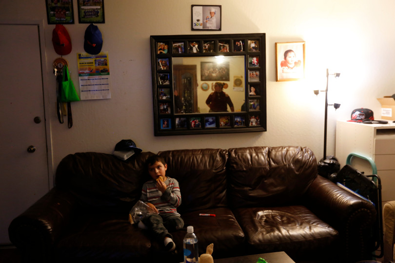 Mountain View, CA - DECEMBER 4: Johnatan Flores Carrillo, 5, has a snack while watching television as his mom Rocio Carrillo works in the kitchen in their apartment on W. Middlefield Rd. in Mountain View, Calif., on Tuesday, Dec. 4, 2018. Mountain View city officials are considering a developer's proposal to raze 20 rent-controlled, affordable apartments and replace them with 15 new, luxury town houses. (Nhat V. Meyer/Bay Area News Group)