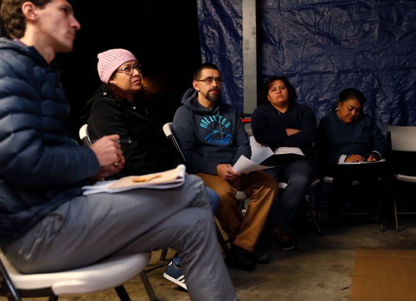 Mountain View, CA - DECEMBER 3: Residents meet in a carport at their rent controlled apartment building along Rock St. in Mountain View, Calif., on Monday, Dec. 3, 2018. They meet every week. Mountain View city officials are considering a developer's proposal to raze 20 rent-controlled, affordable apartments and replace them with 15 new, luxury town houses. (Nhat V. Meyer/Bay Area News Group)