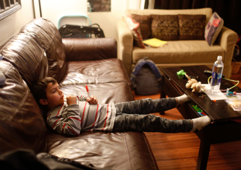 Mountain View, CA - DECEMBER 4: Johnatan Flores Carrillo, 5, watches television in his home on W. Middlefield Rd. in Mountain View, Calif., on Tuesday, Dec. 4, 2018. Mountain View city officials are considering a developer's proposal to raze 20 rent-controlled, affordable apartments and replace them with 15 new, luxury town houses. (Nhat V. Meyer/Bay Area News Group)