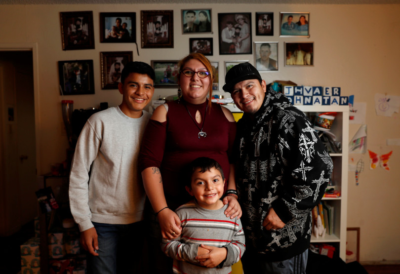 Mountain View, CA - DECEMBER 4: From left to right, Omar Flores, Rocio Carrillo, her husband Roberto Flores and their son Johnatan Flores Carrillo, pose for a photograph in their apartment on W. Middlefield Rd. in Mountain View, Calif., on Tuesday, Dec. 4, 2018. Mountain View city officials are considering a developer's proposal to raze 20 rent-controlled, affordable apartments and replace them with 15 new, luxury town houses. (Nhat V. Meyer/Bay Area News Group)