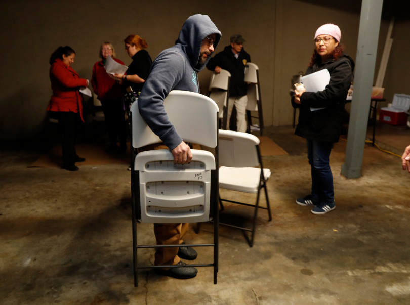 Mountain View, CA - DECEMBER 3: Resident Donis Morales picks up chairs at the end of a meeting of residents in a carport at their rent controlled apartment building along Rock St. in Mountain View, Calif., on Monday, Dec. 3, 2018. They meet every week. Mountain View city officials are considering a developer's proposal to raze 20 rent-controlled, affordable apartments and replace them with 15 new, luxury town houses. (Nhat V. Meyer/Bay Area News Group)