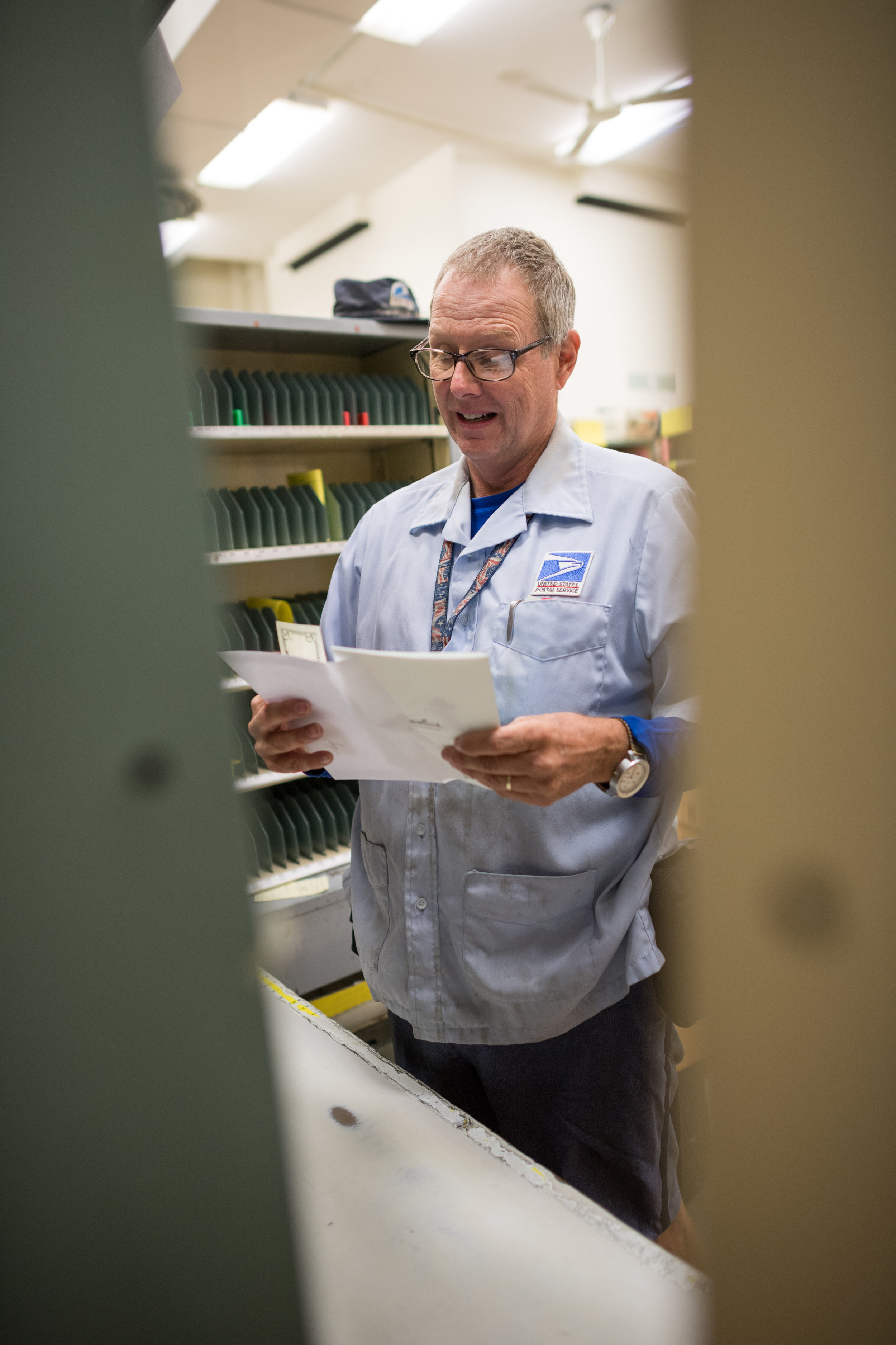 Before loading his truck and starting his route, Greg spends about an hour before each shift sorting mail and loading his cart.