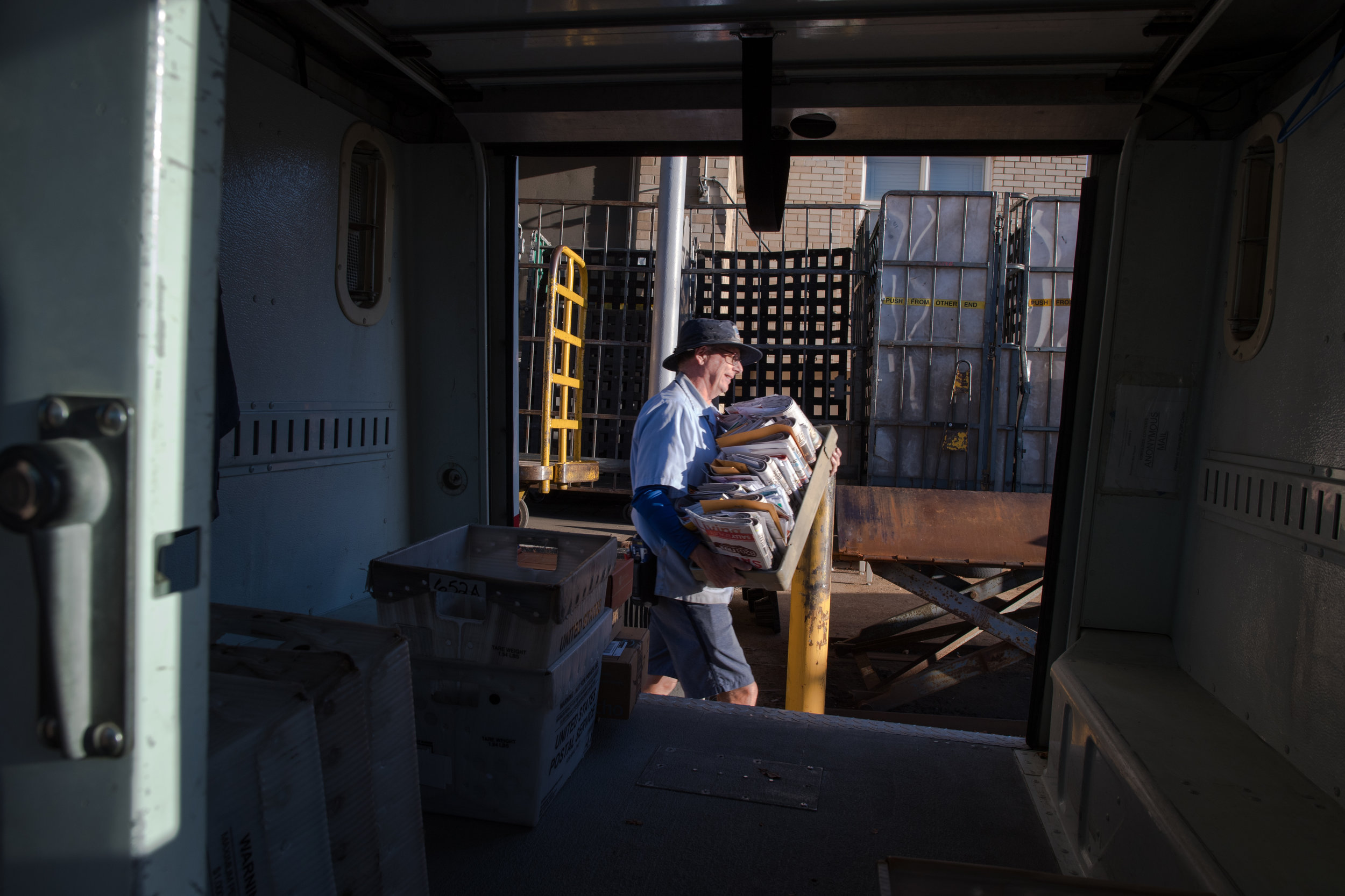 Greg loading his truck before heading out. Greg has driven the same truck since 1994.
