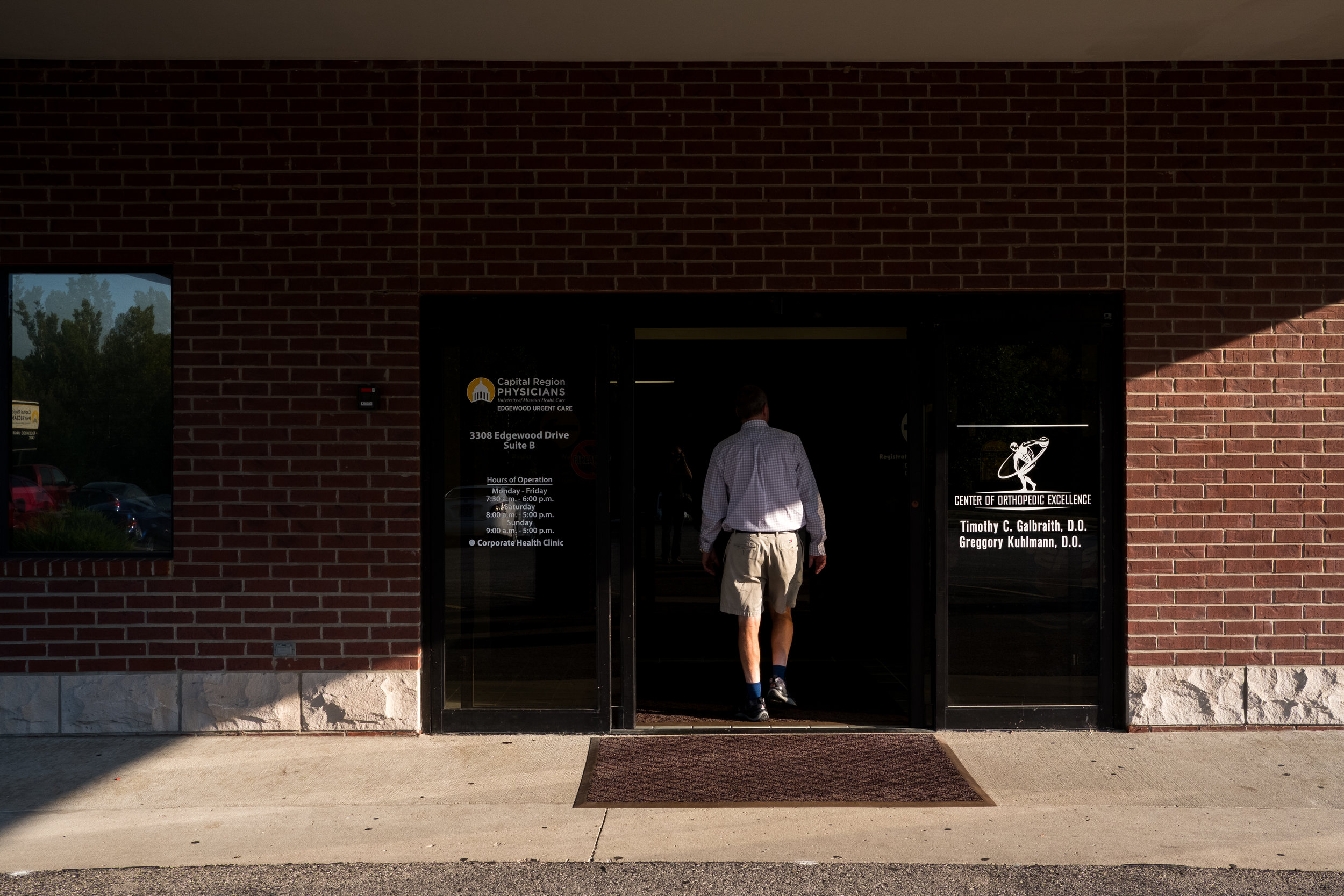 Greg enters a clinic in Jefferson City to meet with his orthopedic surgeon because of an elbow that his been causing him pain.