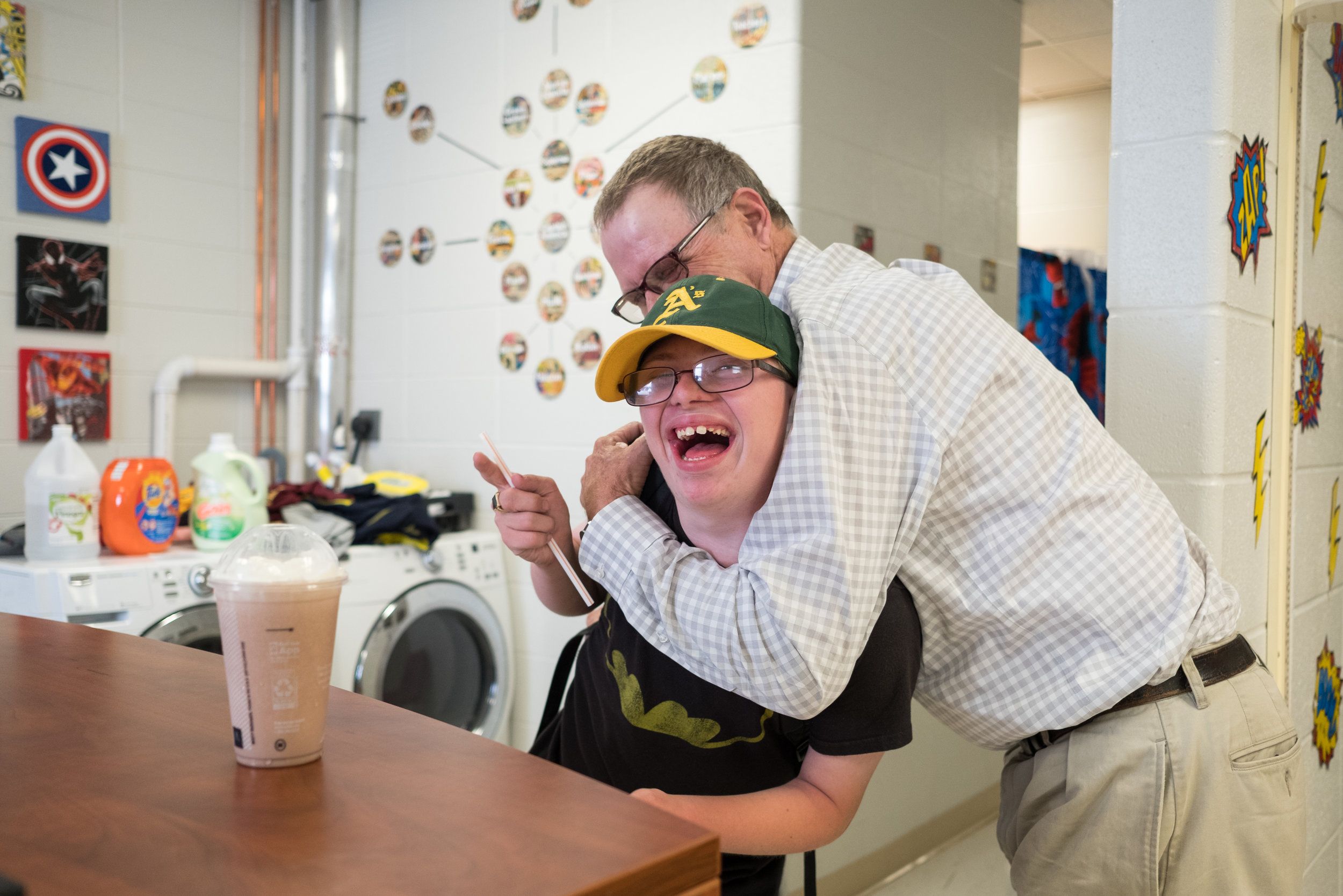 After Greg's shift he picks up a chocolate shake for his son, Luke, to reward Luke for doing well in class. Luke, was born two months premature with a severely damaged heart and Downs Syndrome.