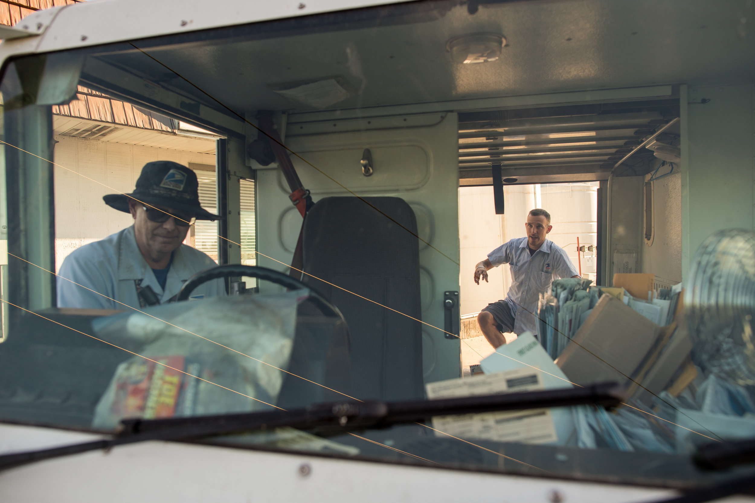 Lee Krueger, steps into the back of the mail truck. Lee joined Greg to learn the route.