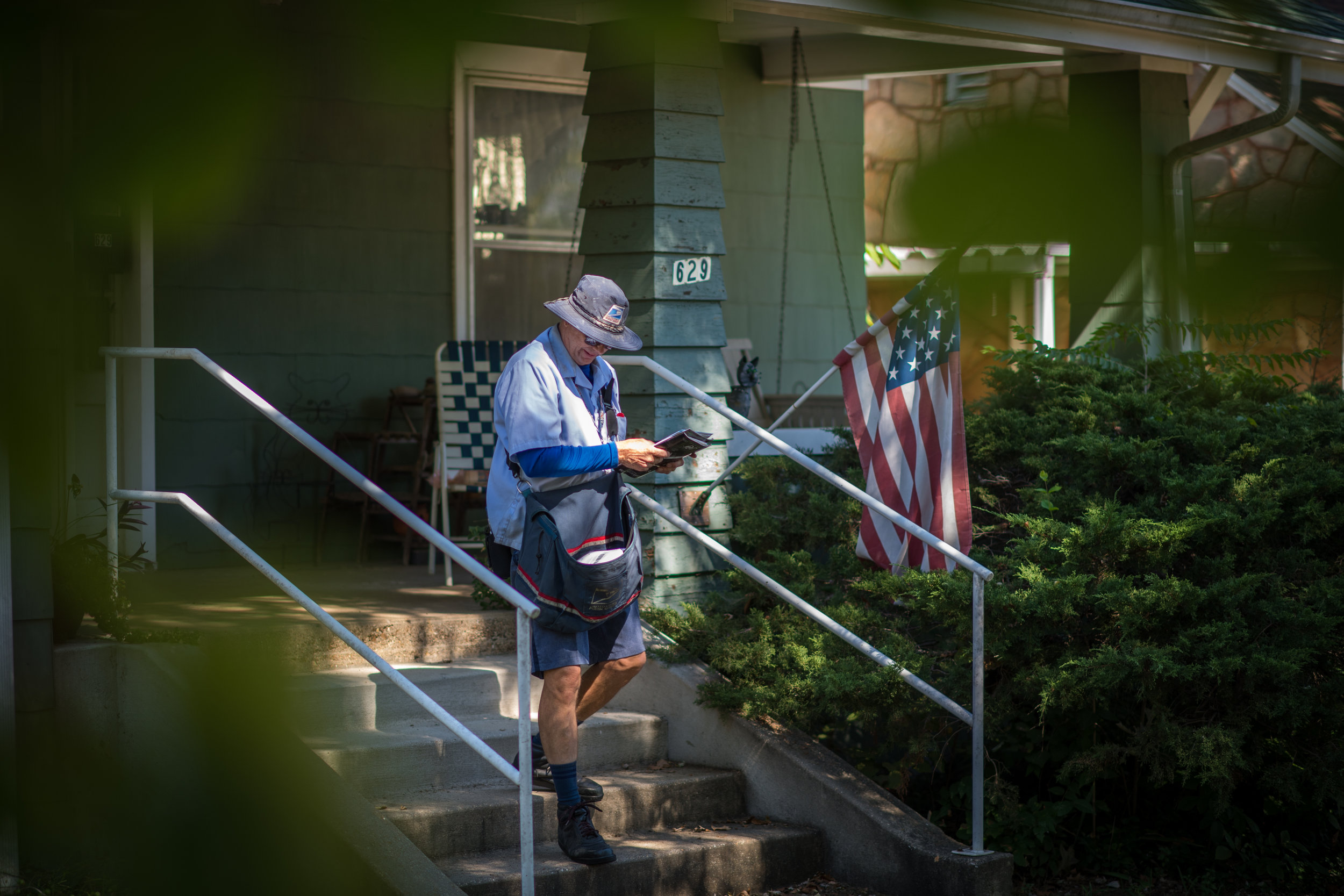 Greg delivering mail on his last week before retirement.