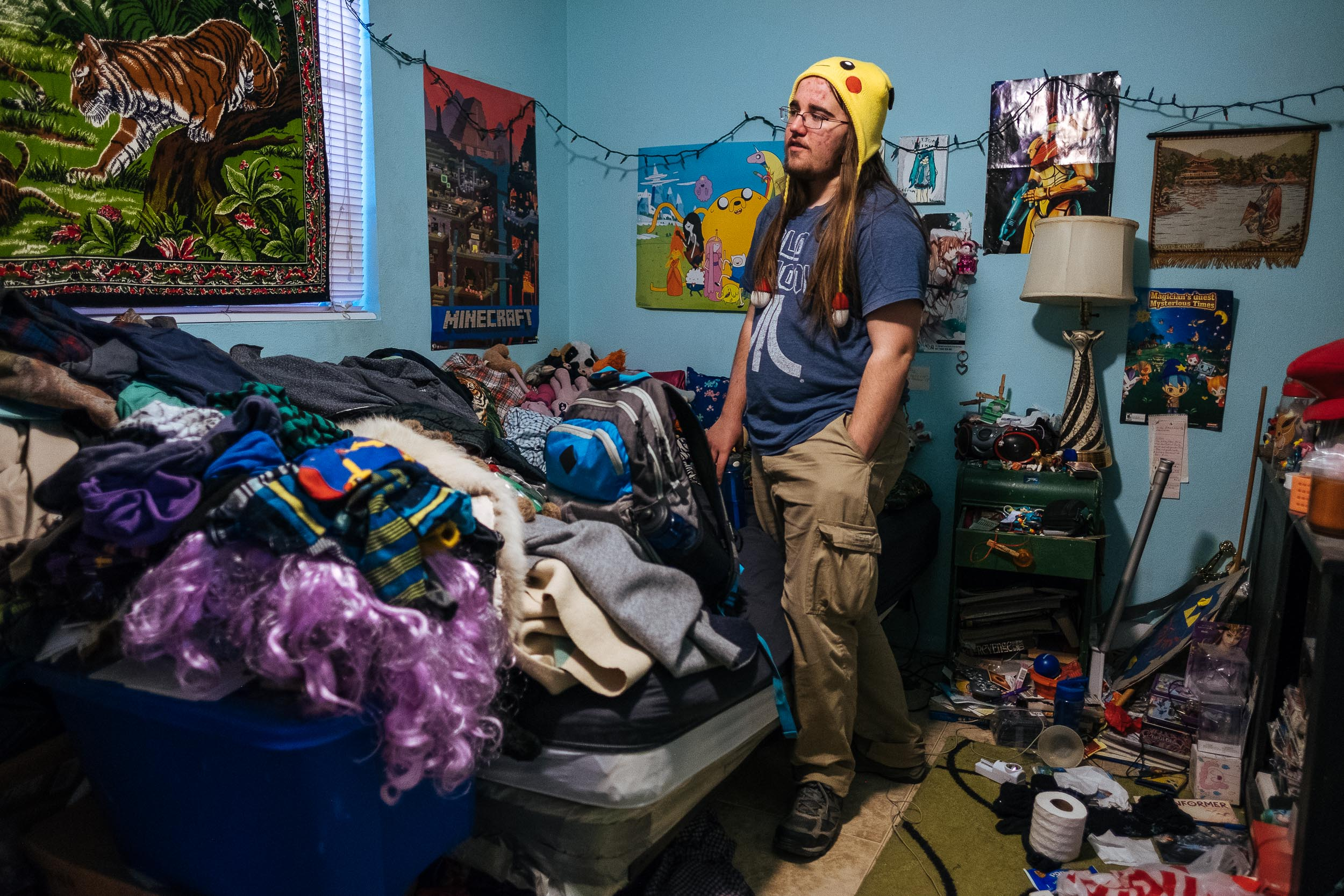 Jenny's son, Zefram, in his bedroom. Zefram is a senior in high school. Despite requiring some special attention scholastically and needing help with navigating change, Jenny describes Zefram as smart and funny. She says Zefram is a good person and that makes her a good mom.