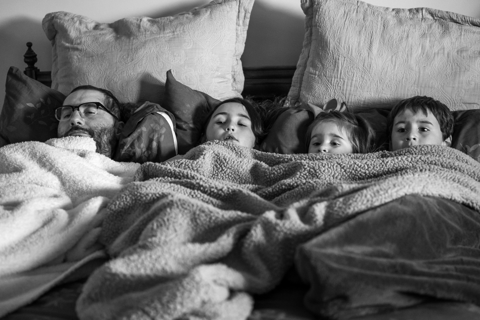 Mike and his children enjoying a movie during a weekend home visit.
