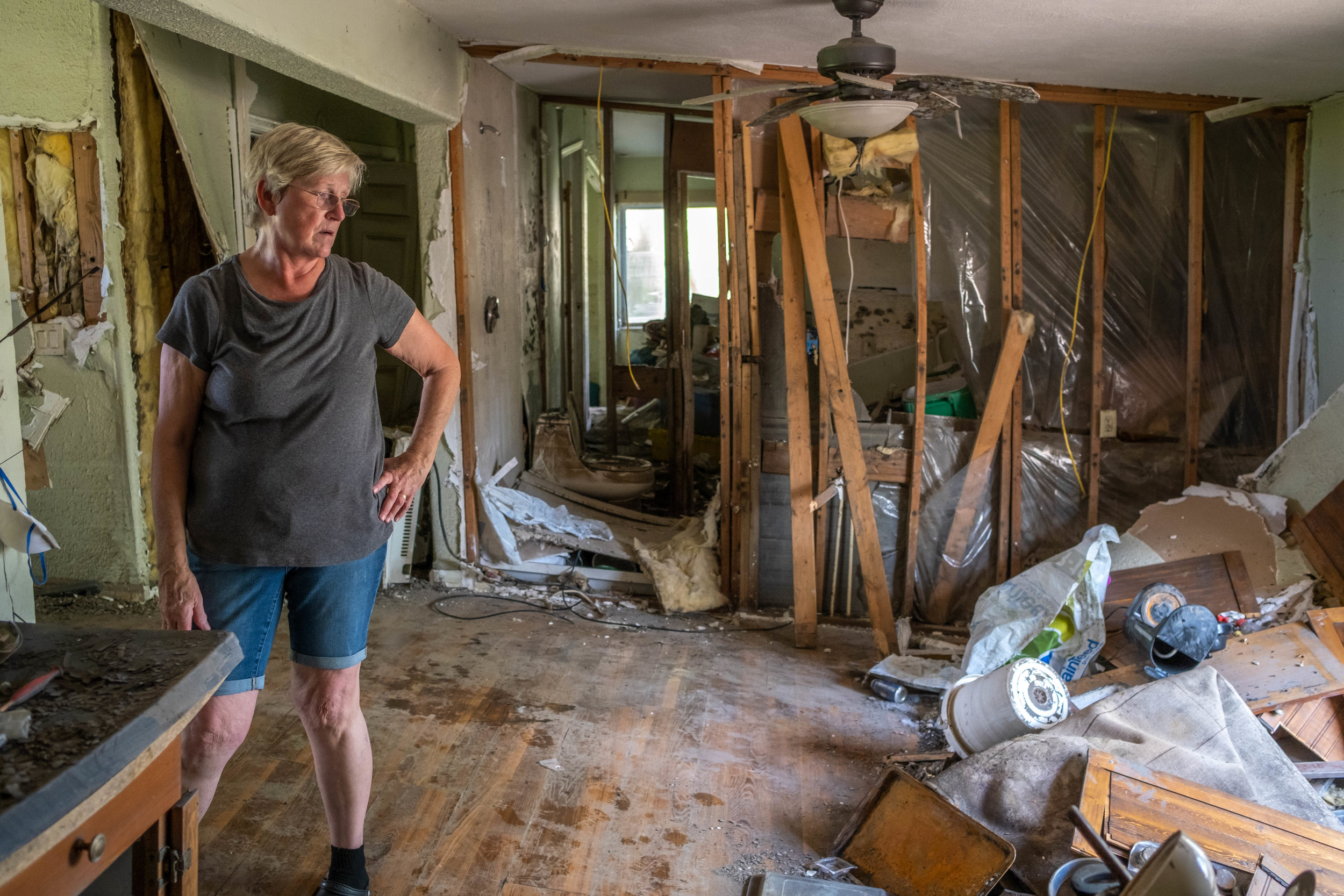 Carol Doty takes a moment to assess the damage. Despite the flood occuring several months back, Carol has only been inside a few times. She's lived in Bartlett since she was 3 years old, and said it's very difficult coming back to all the damage.
