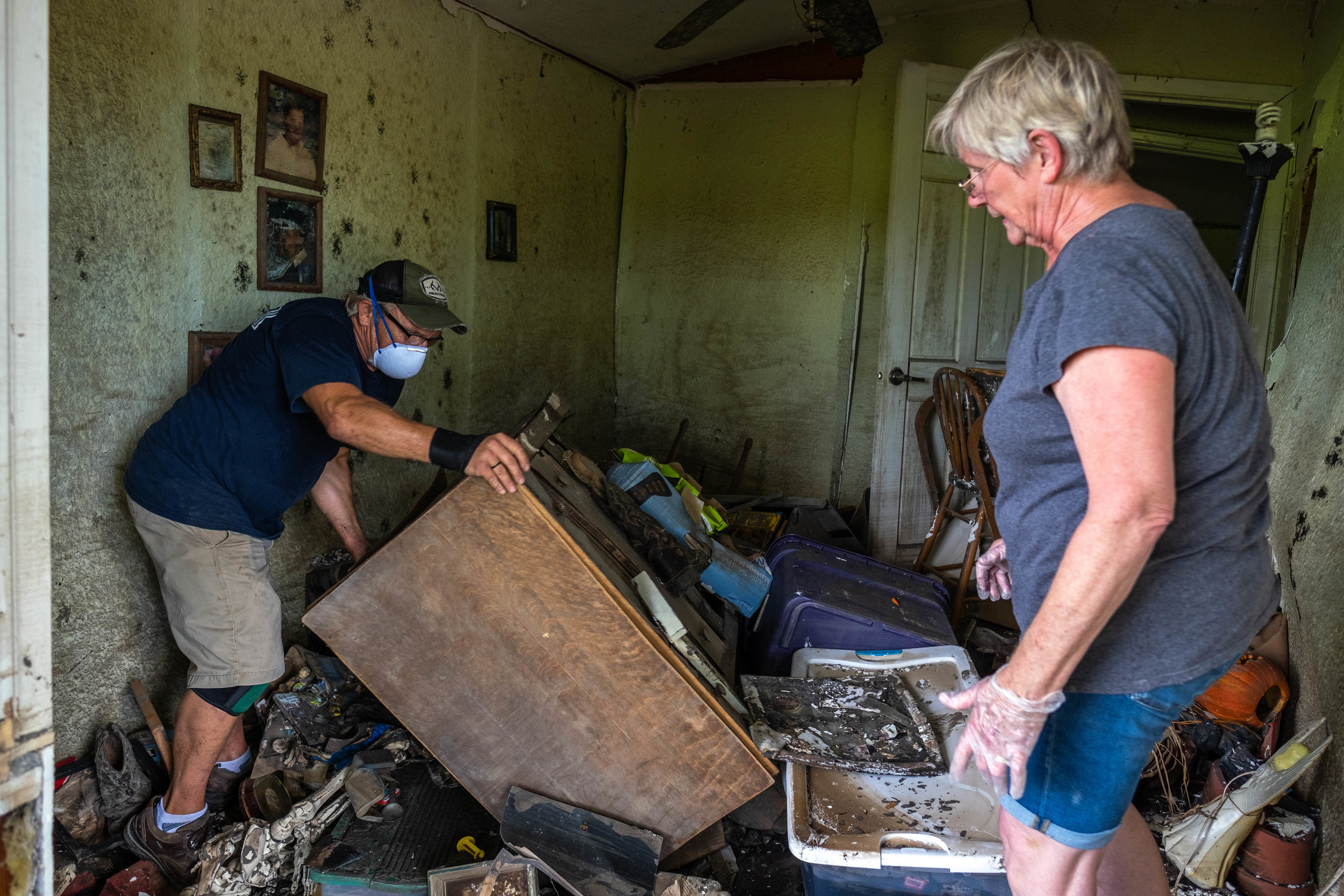 Dean and Carol sort through the remains of the house.