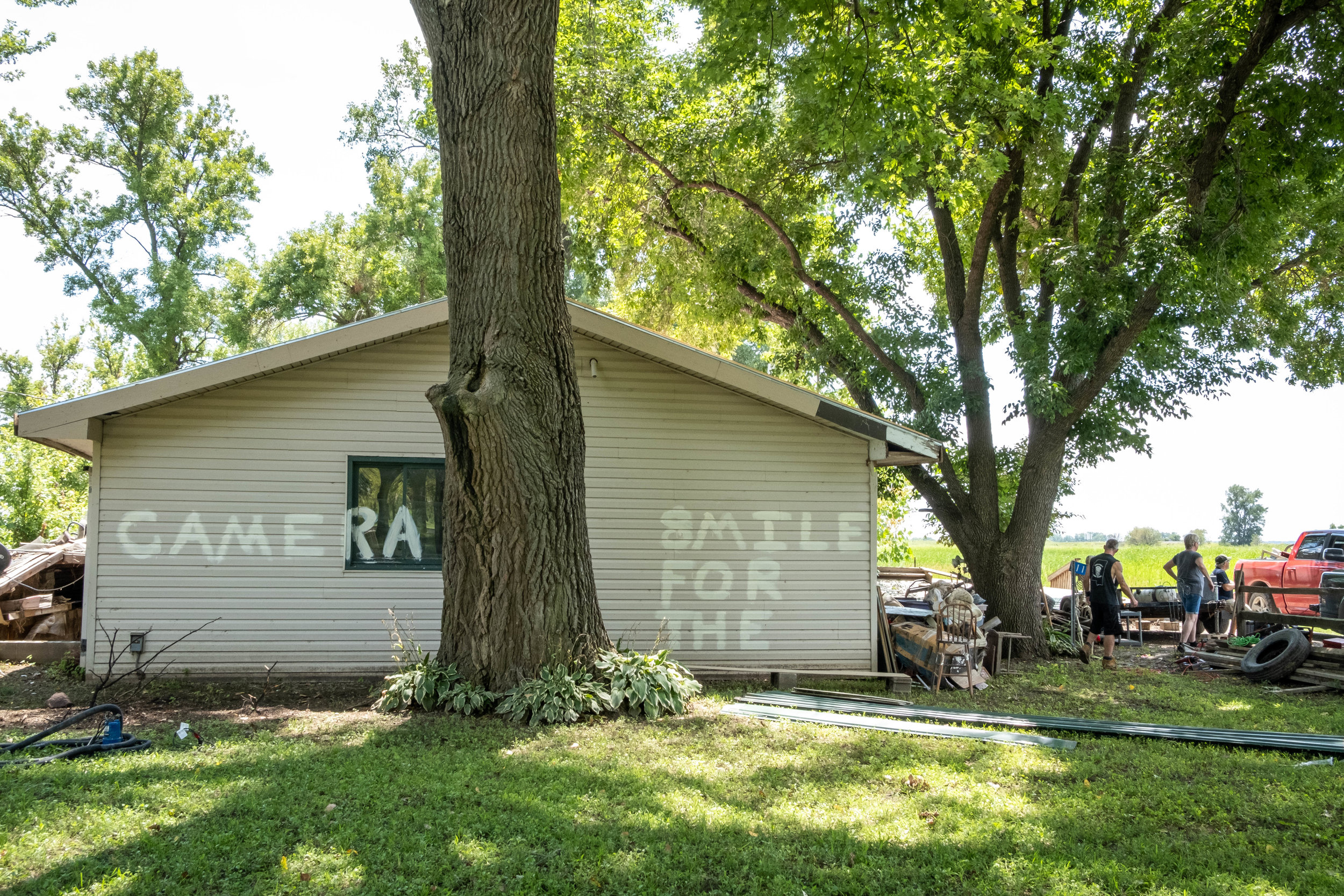 Dean Doty spray painted this message after his homestead was robbed by looters.
