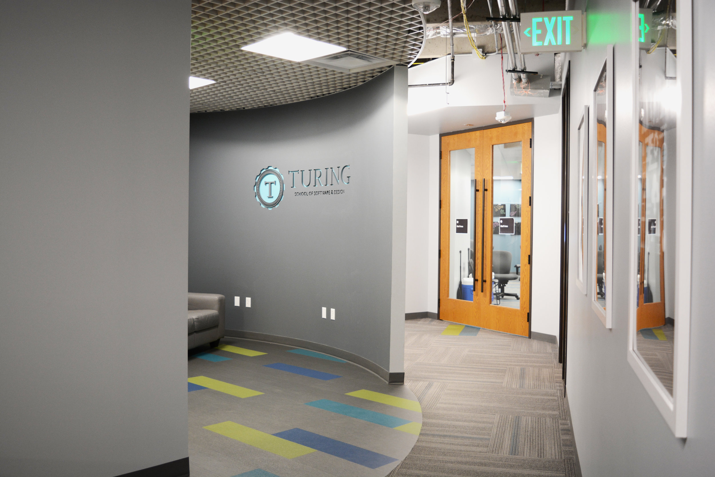 While the space required a devoted entry area, Turing does not operate with a receptionist. We created an interesting entry without dedicating a significant amount of square footage. Patcraft's Mixed Materials Metallix LVT flooring and Armstrong's MetalWorks Open Cell ceiling create multiple colors and textures for a big impact without big sacrifice of area.