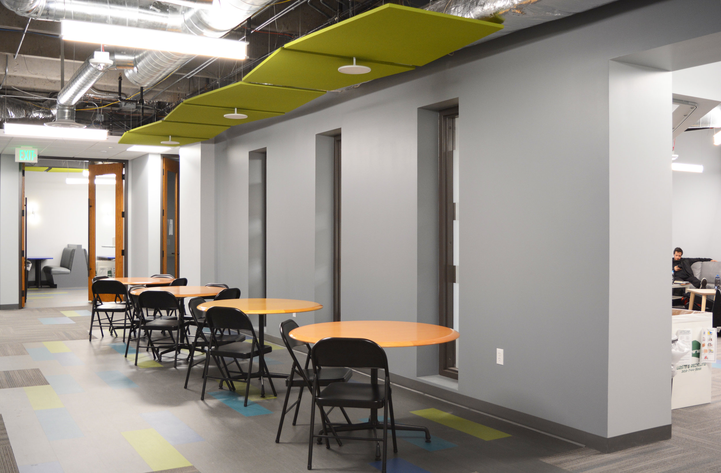 Although class schedules are staggered and the break room was designed to accommodate a generous amount of students, additional space in the suite was needed to handle the volume of all students eating at once. Replacing more of the carpet tiles with LVT allowed the break area to extend from the room itself, and provide a hallway for eating, studying and conversation.