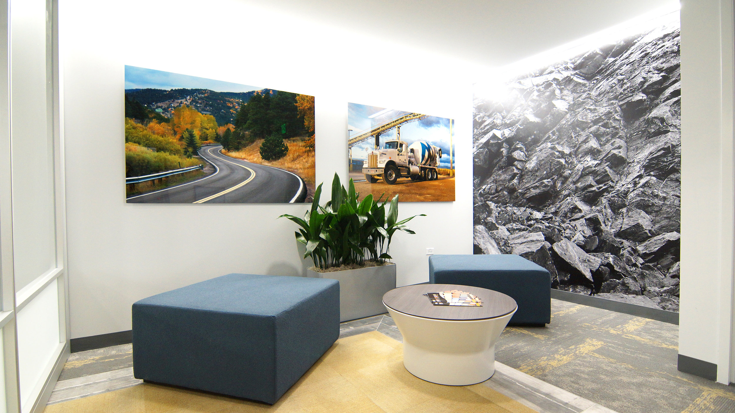 Kestrel's utilization of custom and original imagery throughout the new space reflects the different aspects of Martin Marietta's work was highly important to the client. This photo shows the public side of the reception area where a graphic printed by  Wolf Gordon  of a rock quarry along with photos printed on metal sheets are the focal point, along with a low seating arrangement, leaving the graphics in full view.