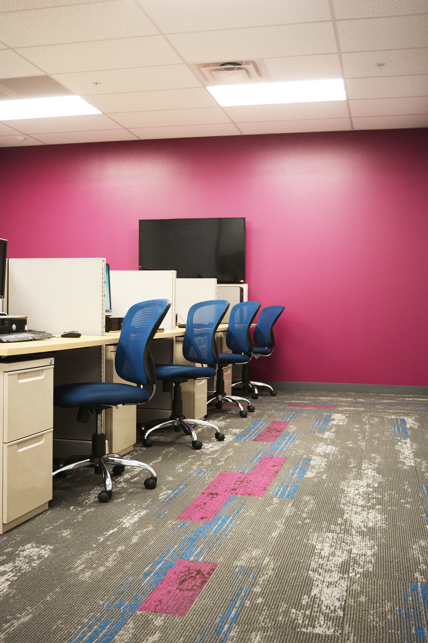 Mohawk's Hyper Earth collection provided the perfect opportunity for Kestrel to create interest by adding color to walkways, paths between desks and within meeting rooms. The additional raspberry cut insets are Mohawk New Vintage, a colorful line that injected lift into the patterns.