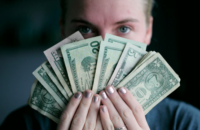 Woman with dollars picture.png