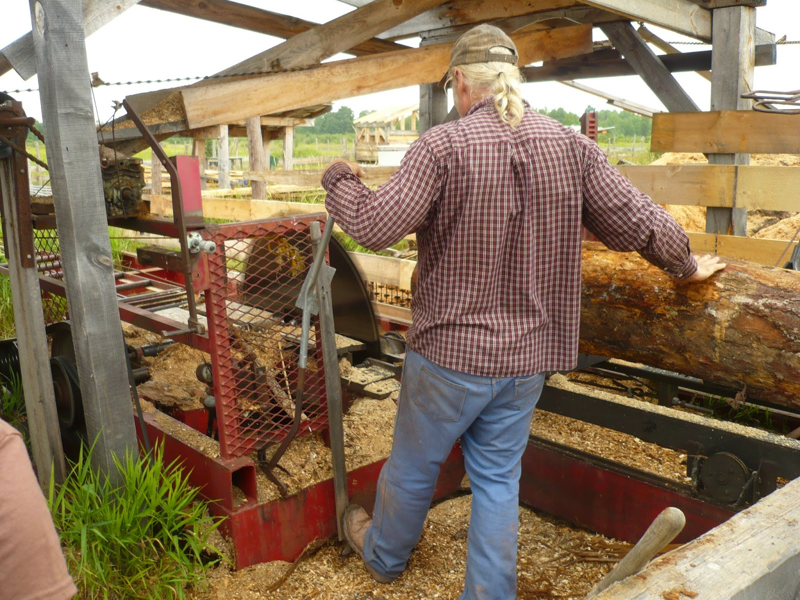 Mel Seeger milling logs at his Matchwood Sawmill. Mel built his own sawmill from an old Mac truck! He is an expert timber-framer and built our beautiful studio barn at VCAC.