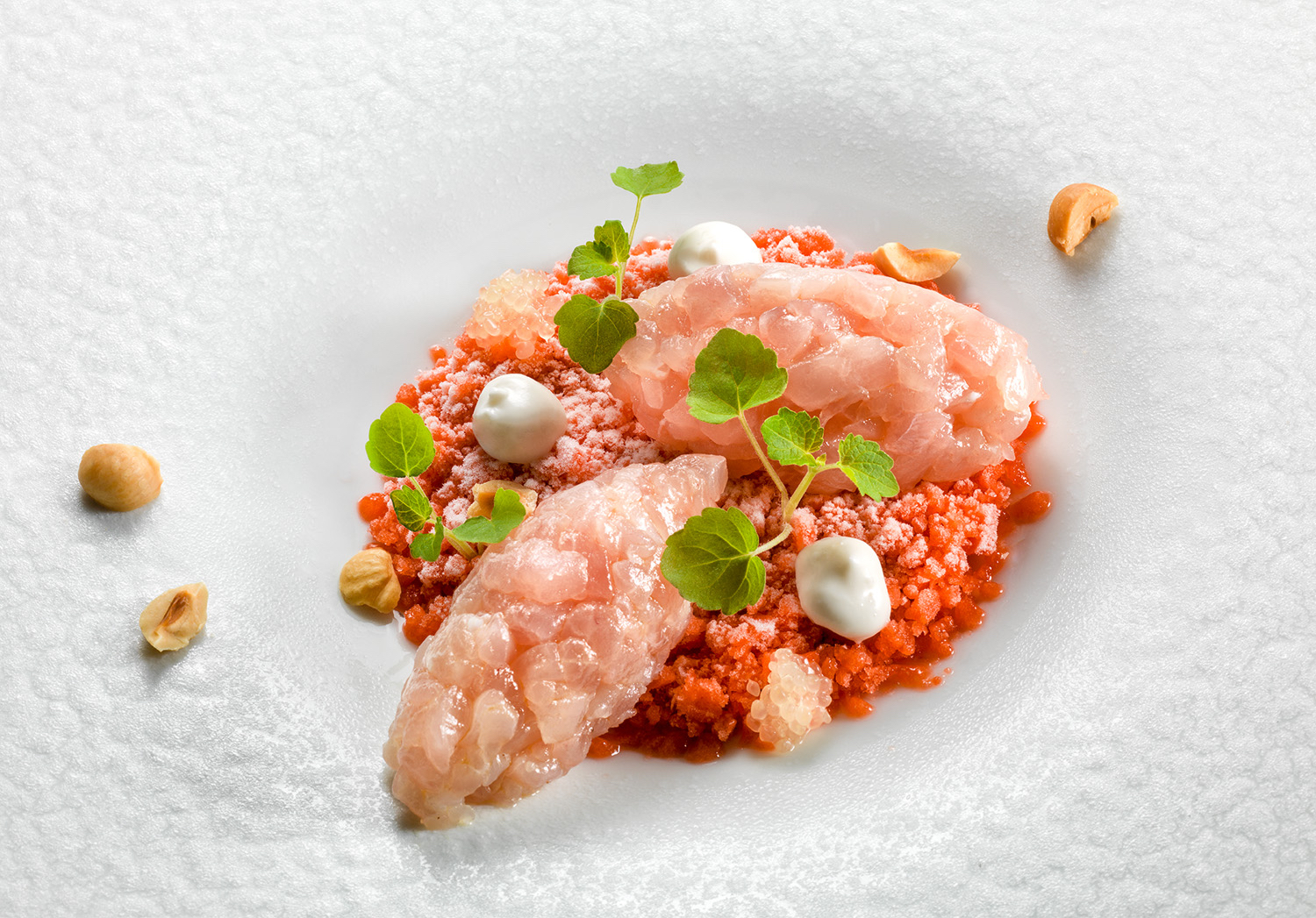 Amberjack tartare on strawberry granita, almond mousse and finger lime.jpg