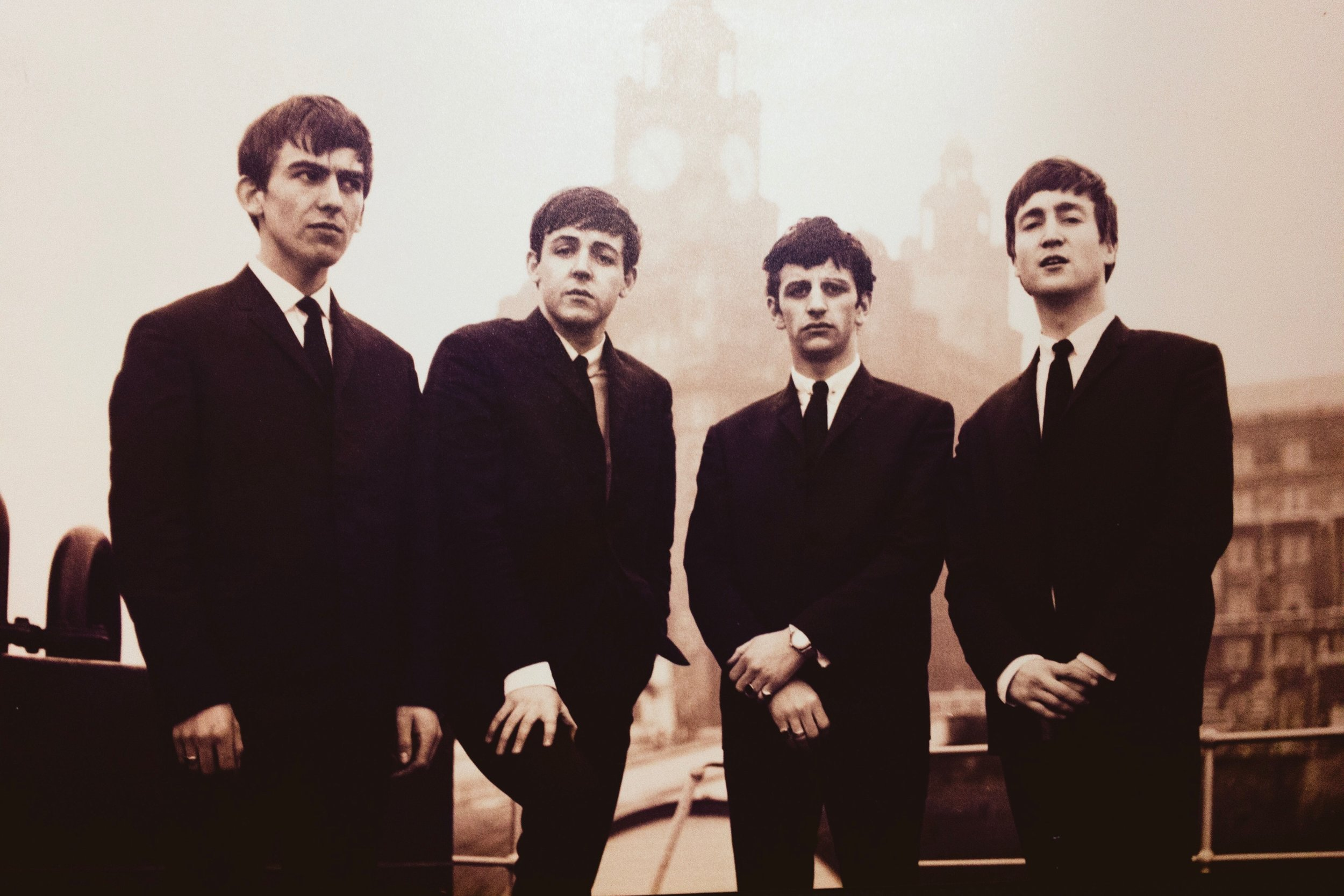 The Beatles looking dapper and kinda serious.
