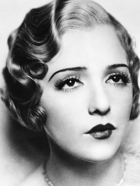 1920's makeup style: finger waves, small lips, eyes.