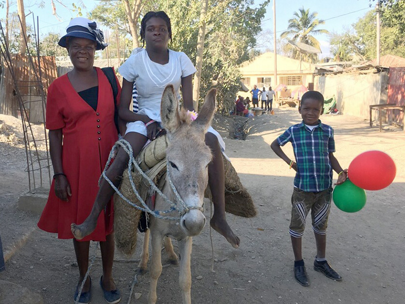 This is one of our special guests Gelina and her grandmother Nayla. Gelina was given a donkey last year to help her travel. We were overjoyed to see her riding the donkey to the party! Read more about Gelina and Nayla's story in  our post  from September 28, 2017.