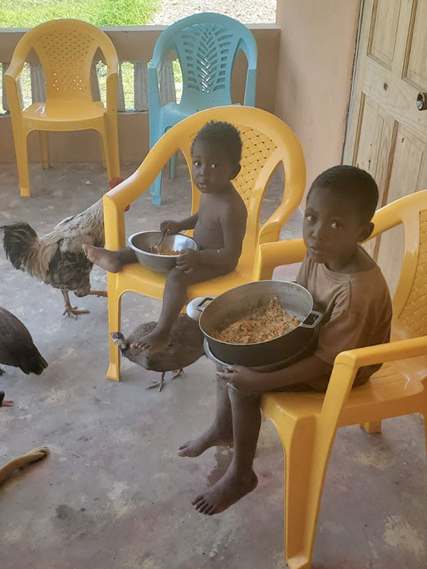 No more dirt floor for meals! - The boys are eating in new chairs, on new concrete floor.