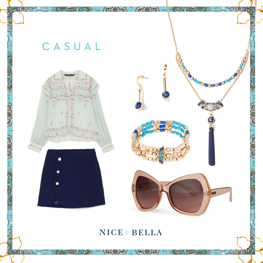 Keep it simple and cute with this  embroidered, ruffled top  and  buttoned mini skirt  that's paired with our gorgeous, golden jewelry with blue tints and stones. The bold blue in the earrings. necklace and bracelet are enough to make a chic statement and upgrade any look! This look is perfect for visiting a new city's museum! Add some dramatic flare to the entire look with our large, maroon shades.  Sku's:  1181322 ,  118873 ,  118874 ,  118736