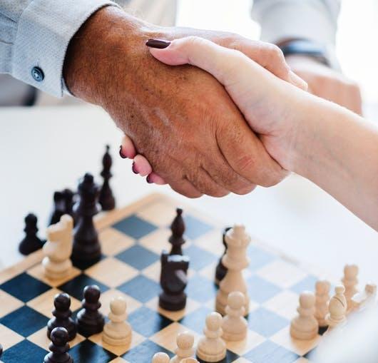 hands+over+chess+board.jpg