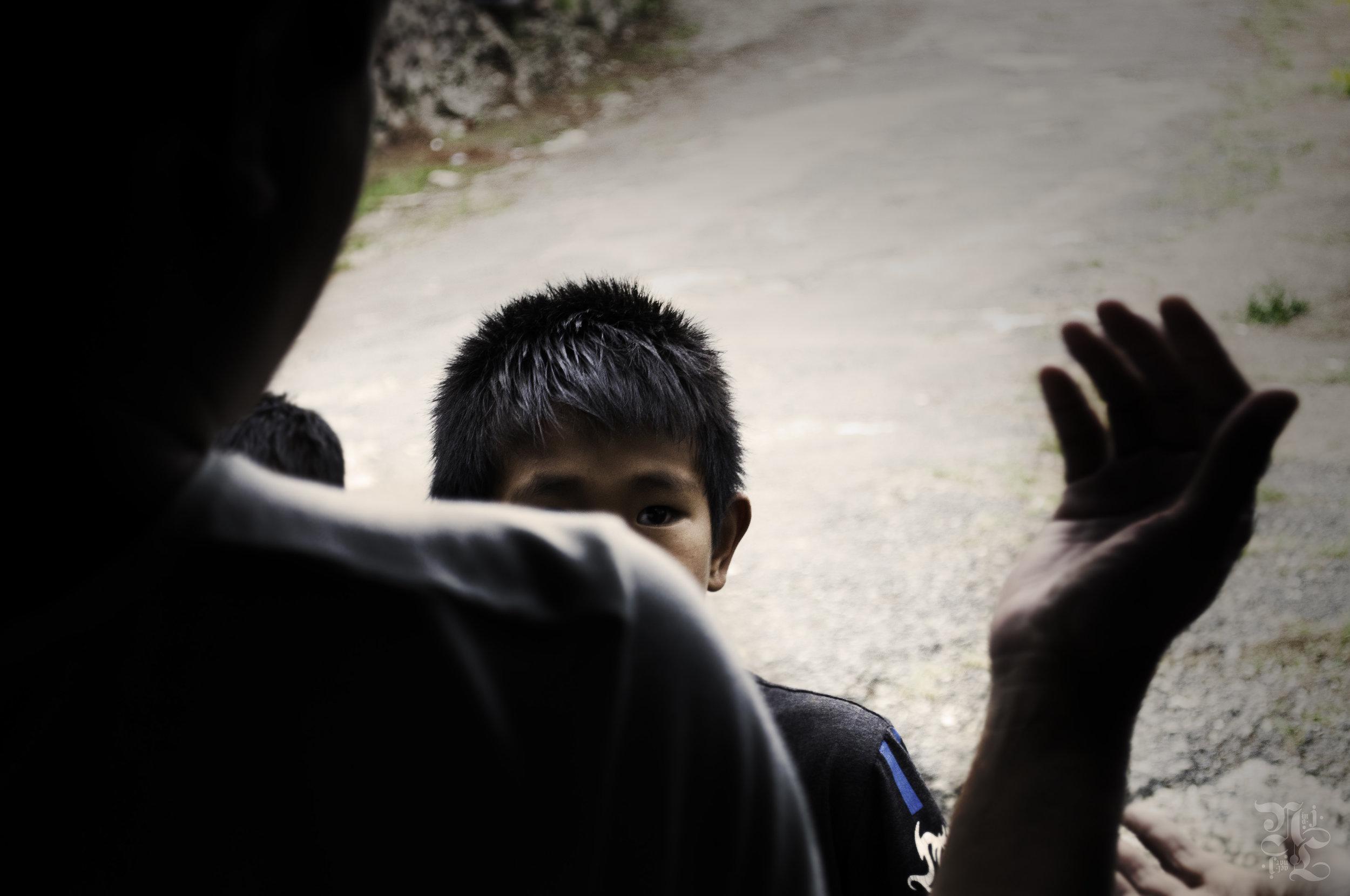 11 yr old boy selling chokoes by a grotto