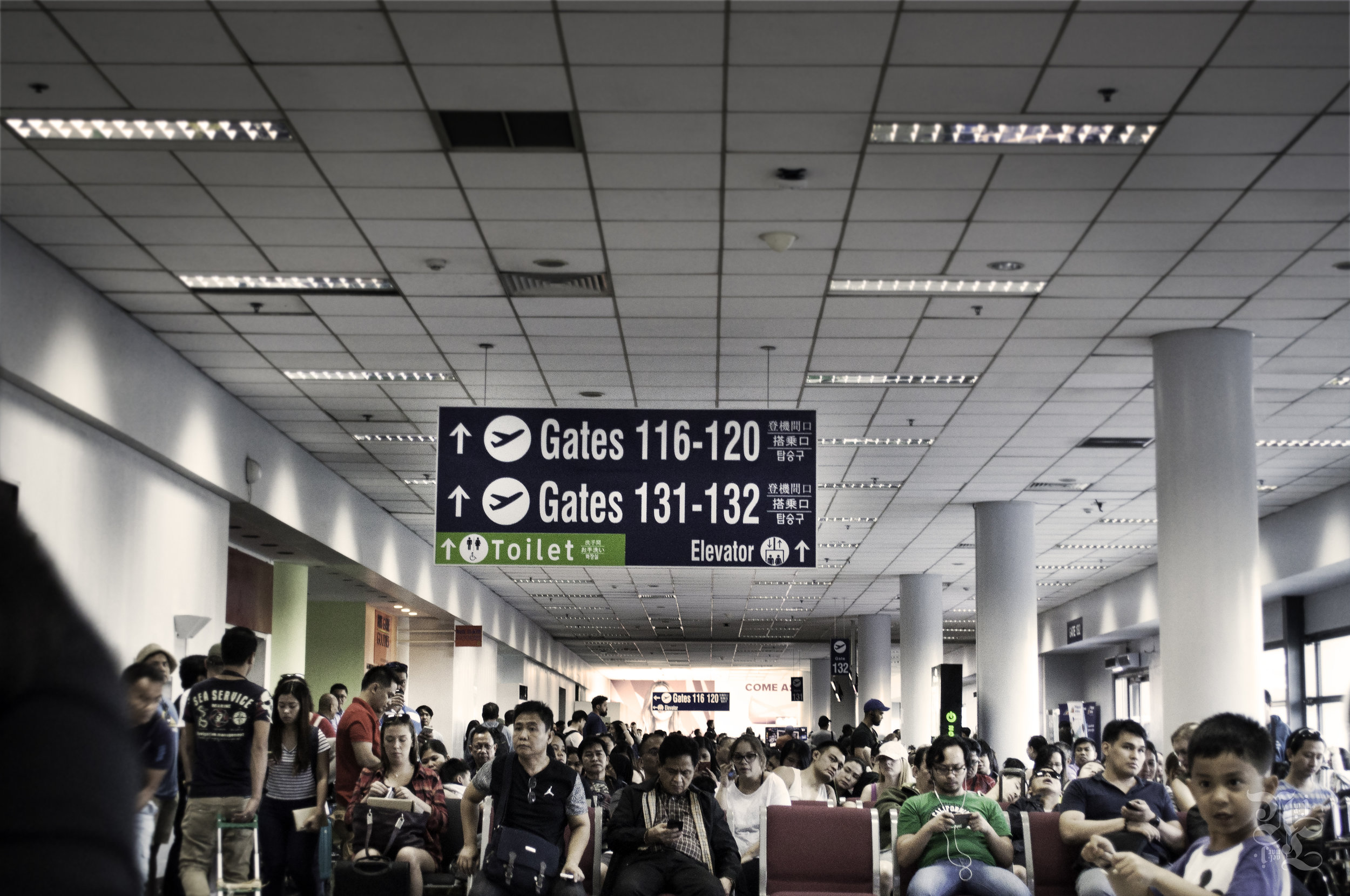 People crowding the NAIA domestic terminal after 4hr+ flight delays