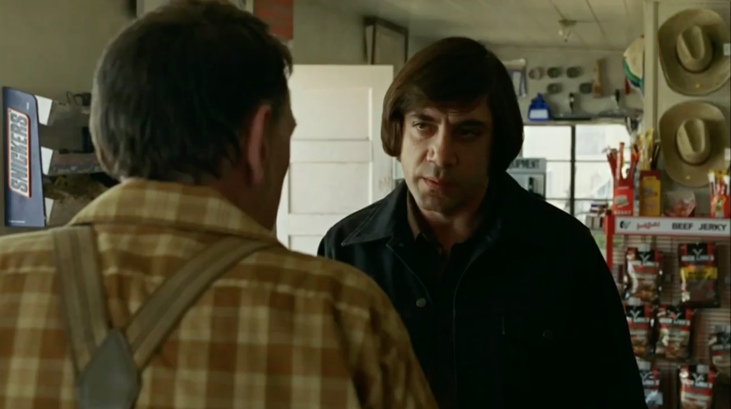 Bardem's hair alone is enough to make him out of place and threatening.