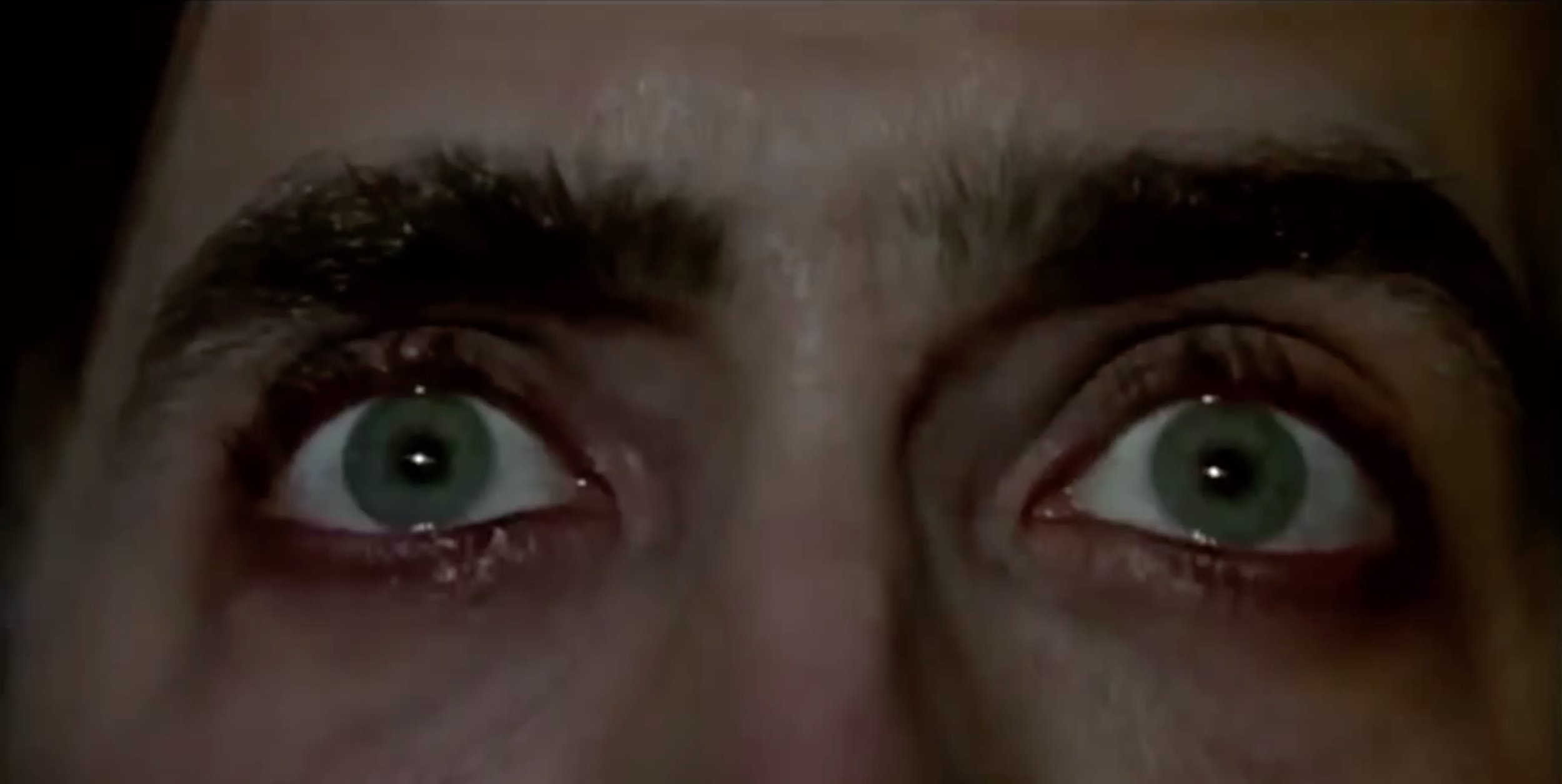 """Wow, you must've seen some things, huh?"" cuts directly into this shot of Cage's eyes."