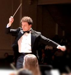 Conductor Alan Buxbaum leads the orchestra in a robust program of both classical and movie classics.