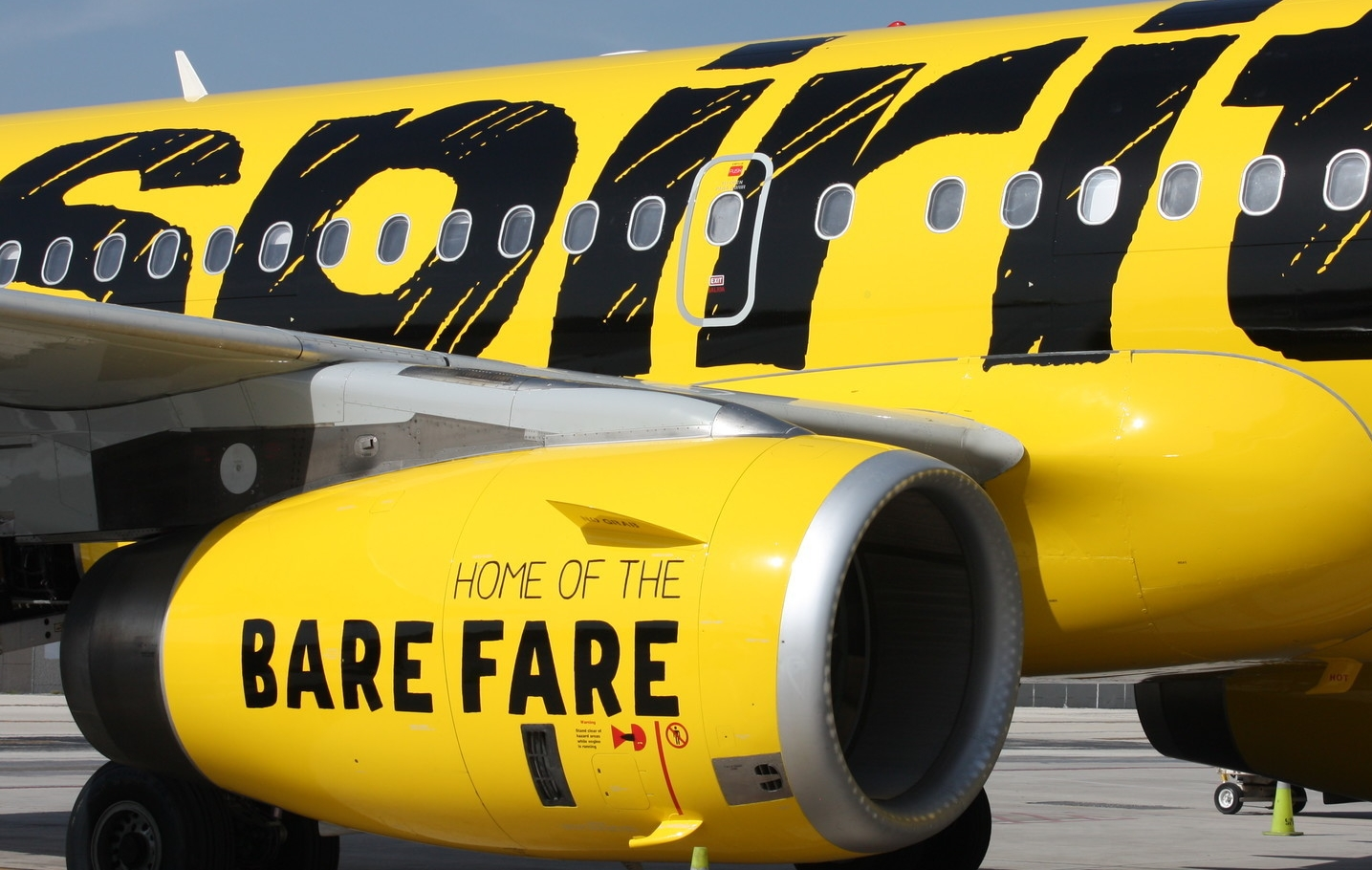Spirit advertises what they are best known for right on the side of their planes.  Source