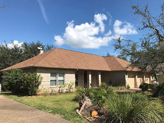 Here's a roofing project we did at Rockport Country Club! These shingles are Pinnacle Pristine Desert with Scotchgard anti algae protection. We paint all hardware to match shingles and are very detailed!  Visit our website TODAY to get a quote—link in profile! 🔨