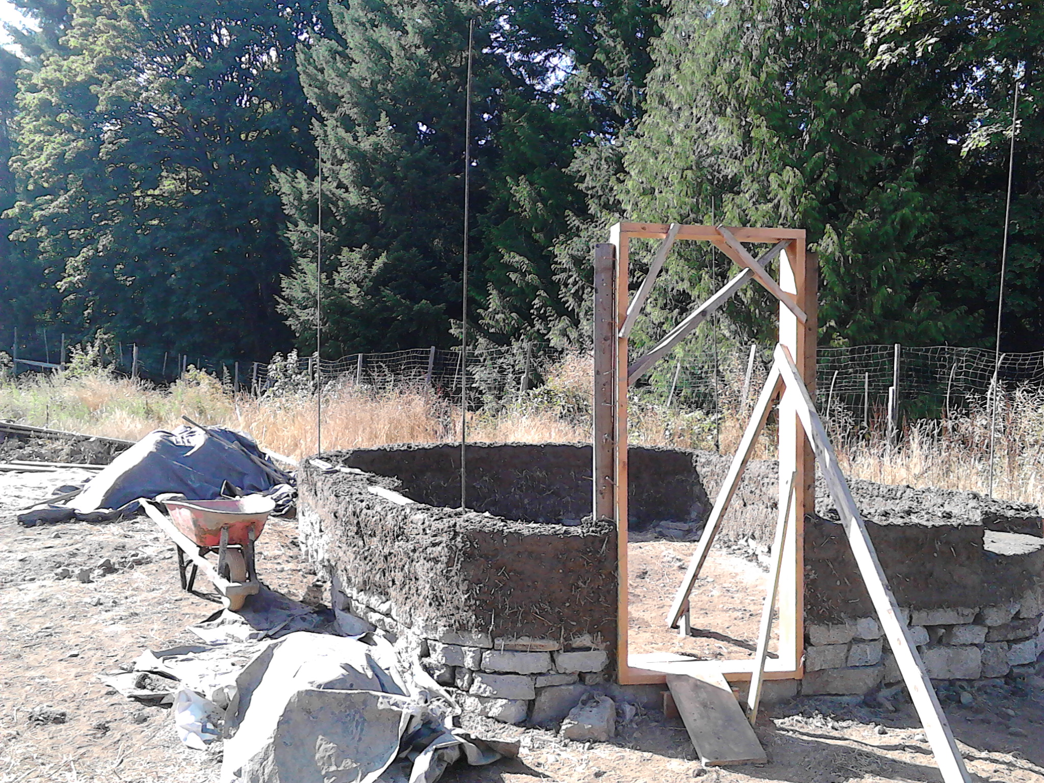 The first few feet of wall going up on a cob structure I designed at OUR Ecovillage, where I was a guest instructor in the summer of 2016.