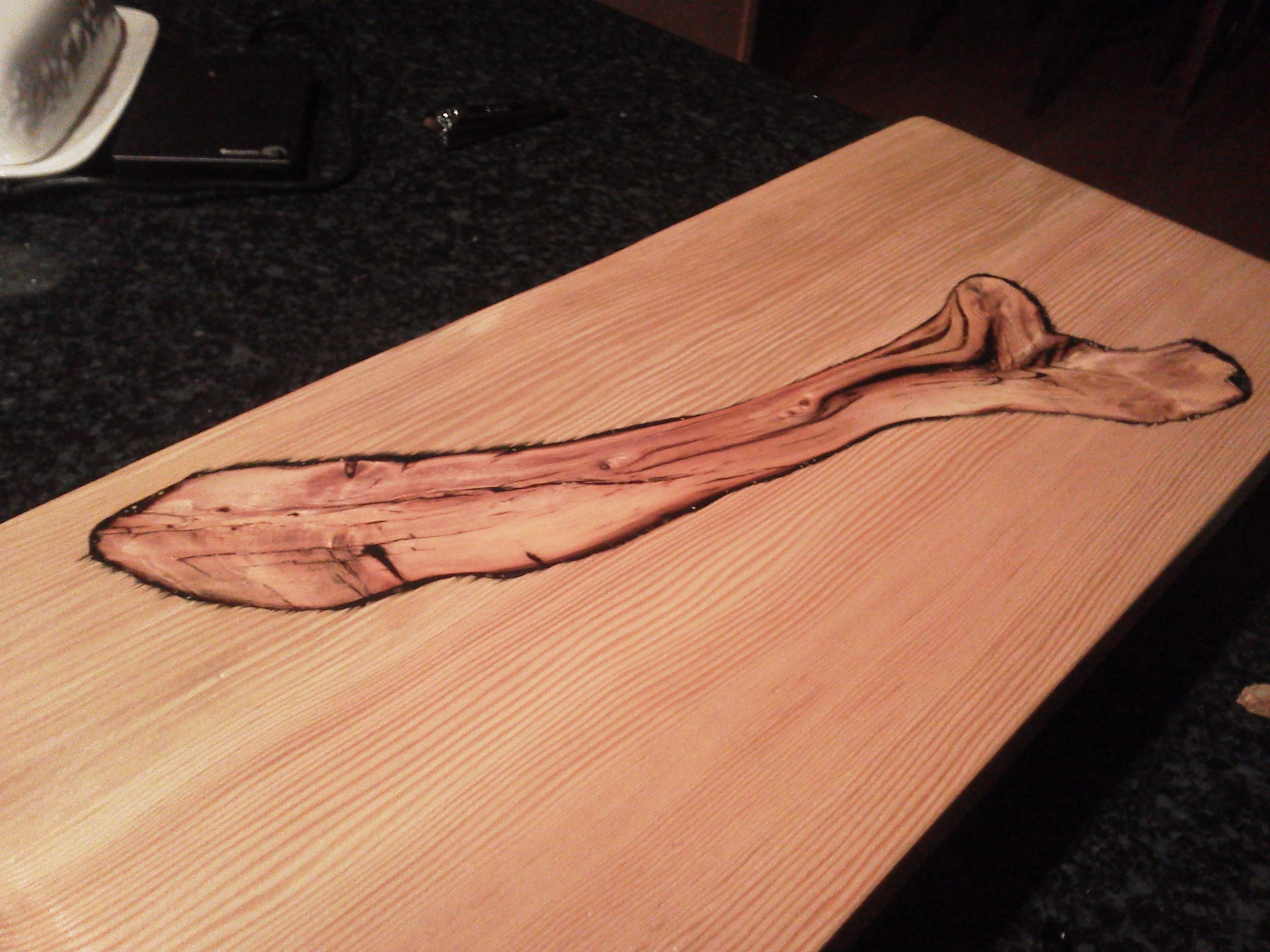 A cutting board I made while experimenting with colored epoxy resins. The inlayed driftwood piece is set in black resin,highlighting and filling the cracks. Next time I have an idea to stop the color bleeding!